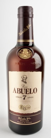 Ron Abuelo 7 Años: Brilliant, deep bronze color. The nose is wonderfully complex and vibrant with alternating aromatics of dried tropical fruits, toffee, toasted coconut, brown baking spices, treacle, cocoa beans, vanilla, and sweet oak. The palate is simpatico with the nose being incredibly lush with layers of fruit and pralines with a dry, spice driven edge. Incredibly balanced with great length. A spectacular brown spirit.